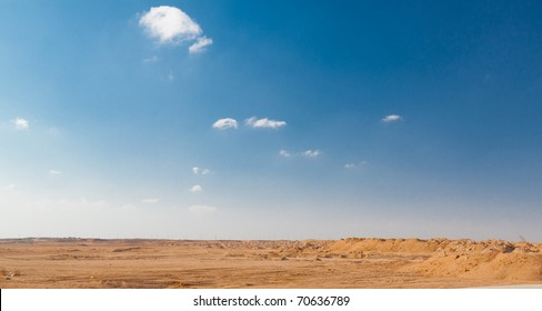 Big yellow sand, desert and blue sky. Nature