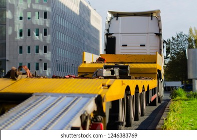 big yellow truck standing by the road