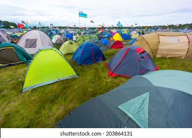 """BIG ZAVIDOVO, RUSSIA - JULY 4: Campsite on open-air rock festival """"Nashestvie"""" on July 4, 2014 in Big Zavidovo, Russia. """"Nashestvie"""" is the biggest rock festival in Russia, more than 200000 visitors"""