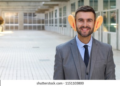 Big-eared businessman smiling in office space