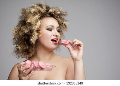 bigger woman eating macarons