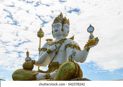 The Biggest Brahma on white clouds and blue sky background, The Hindu God of Creation, in Wat Samanrattanaram Temple. CHA CHENG SAO province, Thailand.