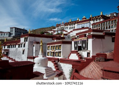 The biggest Buddhist monastery in Tibet - the Ganden monastery near Lhasa with white houses, stupas and temples. Sacred place for Buddha pupils making piligrimage in Asia. Place of prayer and calm.