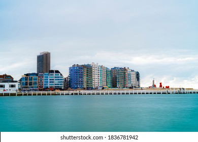 Biggest coast city of flanders, Belgium.  Oostende, Ostend seen from the oostkaai. Bright pop up colours from city seen oversea.  Apartements block at sea belgium.  Flemish region beach.