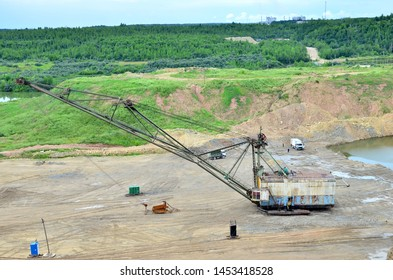 "Biggest excavator dragline with a large bucket for the quarry overburden stripping. Belarus, Vitebsk, largest dolomite deposit in a open pit ""Gralevo"""