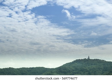 biggest statue of buddha on top mountain