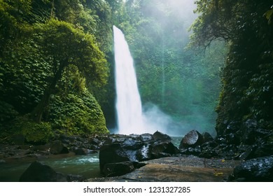 Biggest waterfall with powerful flow in Bali. Tropical forest and waterfall
