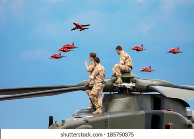 BIGGIN HILL, KENT/UK - JUNE 28 : Helicopter crew watching the Red Arrows display at Biggin Hill Kent on June 28, 2009. Unidentified men.