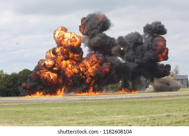 Biggin HiLL,UK,August 18th 2018, Large explosions with flames and thick black smoke on the runway during the Festival Of Flight mock World War ll simulation