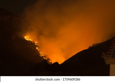 Bighorn Fire consuming the Catalina Mountains at Night as seen from Catalina Foothills in Tucson Arizona on June 18 2020.
