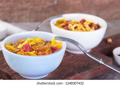 Bigos - stewed cabbage with carrots , smoked sausages and mushrooms, traditional dish of polish cuisine.