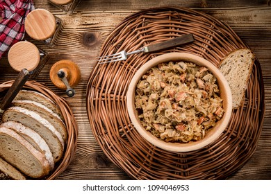 Bigos - stewed cabbage with meat,dried mushrooms and smoked sausage. Traditional dish of polish cuisine. Top view.