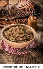 Bigos - stewed cabbage with meat,dried mushrooms and smoked sausage. Traditional dish of polish cuisine.