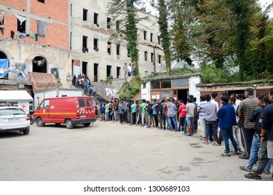 Bihac, BiH, July 07th 2018 Camp for Refugees and migrants. Food distribution for hungry migrants. People standing in line and waiting for food in migrant shelter. Balkan Route. The European migrant cr