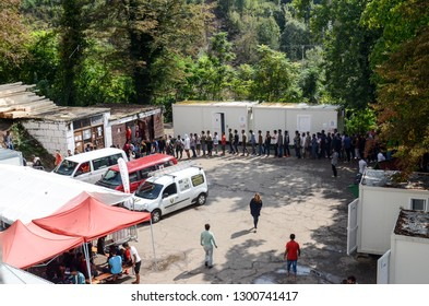 Bihac, BiH, July 07th 2018 Camp for Refugees and migrants. Food distribution for hungry migrants. People standing in line and waiting for food in migrant shelter. Balkan Route. European migrant crisis