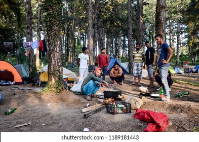 Bihac, BiH, September 01, 2018 - Migrants and refugees live in hard condition in camp in Bihać. Food line.  European migrant crisis. Migrants using Balkan route through Bosnia  to reach EU