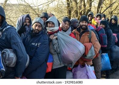 Bihac, Bosnia and Herzegovina, 28 Dec 2020: A group of migrants on their way to EU. Camp Lipa, BiH. Balkan route.