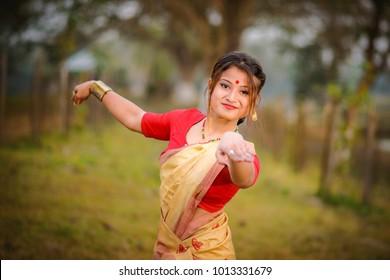 Bihu- Traditional dress of Assam with cultural bihu dance by Assamese girl.