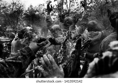 Bijar, Iran - November 04, 2014 : Shias mourning in Ashura in bijar, Iran. They make fire, wail and lament. During the rituals they mud themselves.