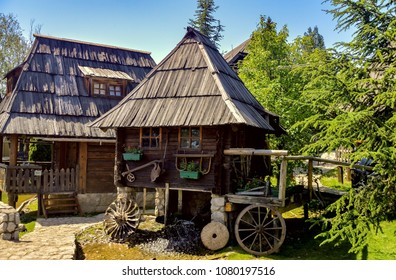 BIJELJINA, BOSNIA AND HERZEGOVINA, April 26 2018: Water mill and old wooden house in Ethno Village Stanisici in Bijeljina, Bosnia and Herzegovina.