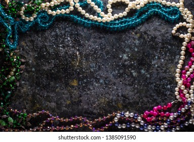 Bijouterie flat lay with mixed jewelry on rustic wooden background