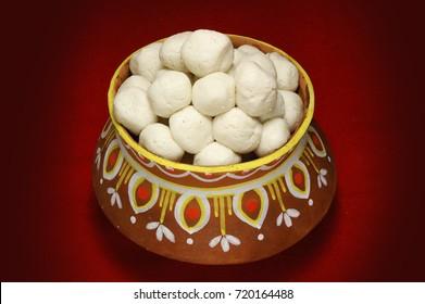 bijoyar misti mukh with rosogolla (a sweet delicacy)