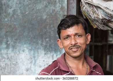 BIKANER, INDIA - 0CTOBER 12, 2015: Indian male portrait  sitting outside of his shop in the old market of Bikaner