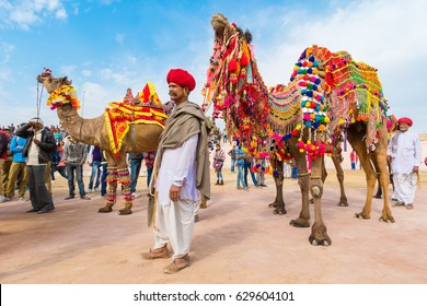 Bikaner, India, 14th January 2017 -  A Rajasthani man with his decorated camel at the Bikaner Camel Mela in Rajastan, India.