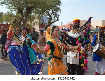 BIKANER, INDIA - JANUARY 12, 2019: Band in traditional clothes performing at festival in Rajasthan state. The Camel Festival begins with a colourful procession of camels, musicians and dancers