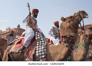 BIKANER, INDIA - JANUARY 12, 2019: Camel band performing at festival. The Camel Festival begins with a colourful procession of bedecked camels against the rugged backdrop of the Junagarh fort.