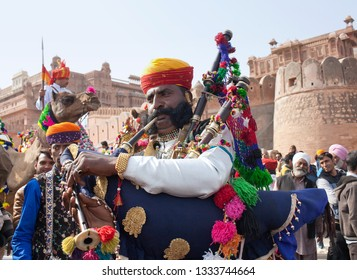 BIKANER, INDIA - JANUARY 12, 2019: Bagpiper band performing at festival in Rajasthan state. The Camel Festival begins with a colourful procession of camels, musicians and dancers.