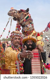 BIKANER, INDIA - JANUARY 12, 2019: Indian Rajasthani men in traditional clothes poses for a photo during Camel Festival in Rajasthan