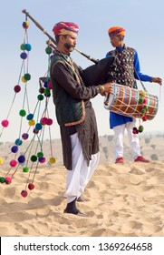 BIKANER, INDIA - JANUARY 12, 2019: Indian band in traditional clothes performing during Camel festival in Thar desert in Rajasthan state