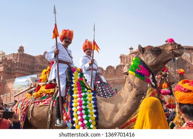 BIKANER, INDIA - JANUARY 12, 2019: Indian warriors riding on camel during festival in Rajasthan. The Camel Festival begins with a colourful procession of bedecked camels.