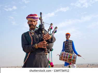BIKANER, INDIA - JANUARY 12, 2019: Indian band in traditional clothes performing during Camel festival in Thar desert in Rajasthan state.