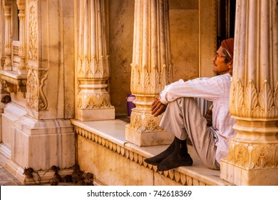 BIKANER, INDIA - MARCH 2017: Indian Man Sitting in Karni Mata Temple AKA Rat Temple