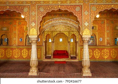 Bikaner, Rajasthan, India, December 15,2017: Junagarh Fort view of the Private Audience Hall in Anup Mahal and Maharaja throne with intricate gold carvings.