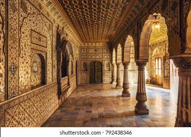 Bikaner, Rajasthan, India, December 15,2017: Junagarh Fort view of the Private Audience Hall in Anup Mahal with intricate gold artwork and columned structure.
