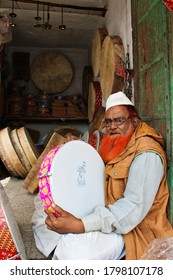 Bikaner, Rajasthan / India - March 07, 2020: Frame Darm (Dhup) at Man Market, Bikaner, playing in the frame Darm, sitting in the seller's shop
