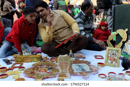 Bikaner, Rajasthan - January12, 2020: Artist doing beautiful paintings with gold (Usta art) on a wooden frame in the streets inside Bikaner