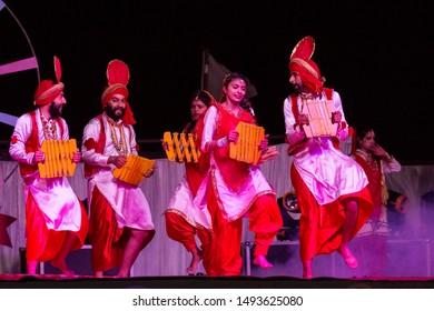 Bikaner, Rajasthan/India - Jan 2019 : Artists of Punjabi dance group performing famous Bhangra dance performance at Bikaner Camel Festival