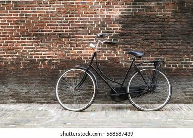 Bike against brick wall