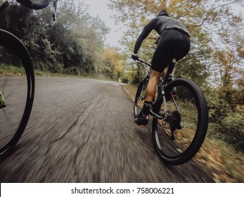Bike at the autumn sunset on the road. Cycle closeup wheel on blurred autumn background.