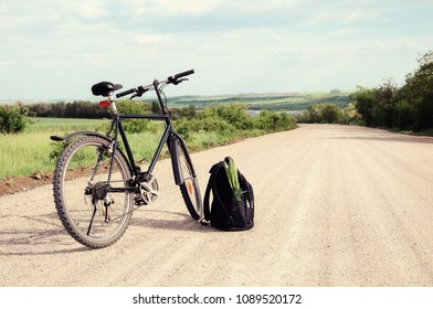 Bike and backpack on the road.