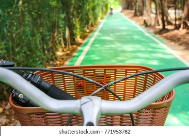 bike or bicycle lane or street with sign and vision in front of the bike with the basket and nature in park