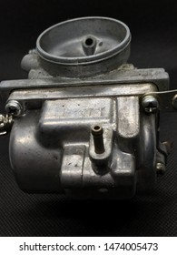 Bike carburetor on black background