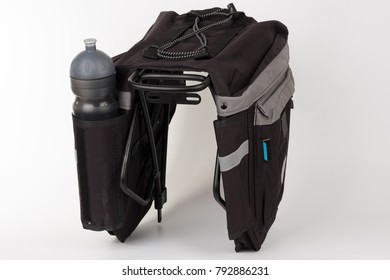 Bike carrier bag on rear rack , in pocket is water bottle, studio photo, isolated on white background