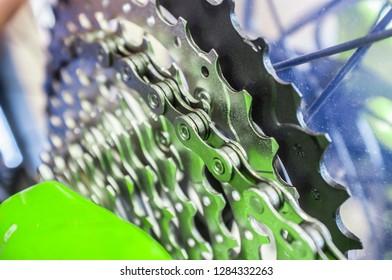 Bike chain links over chainrings on MTB. Closeup. Selectuiva focus