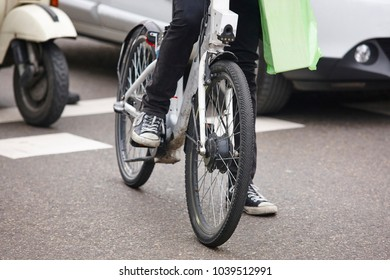Bike in the city. Urban traffic. Healthy activity