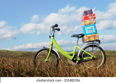bike with gifts. bike stands in the middle of the field with a pile of gift boxes, the concept of the upcoming holiday